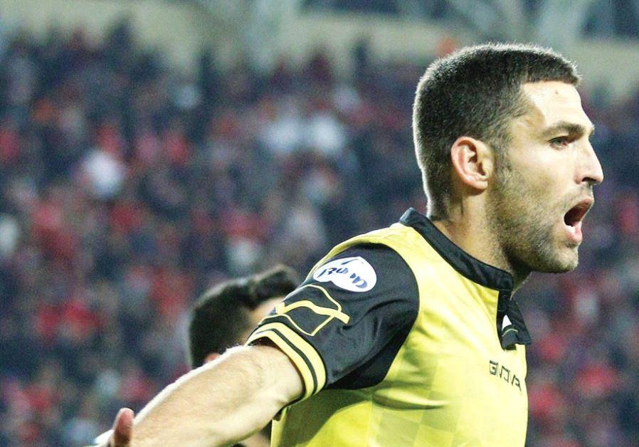Beitar Jerusalem forward Itay Shechter celebrates after scoring the winner in last night's 2-1 victo