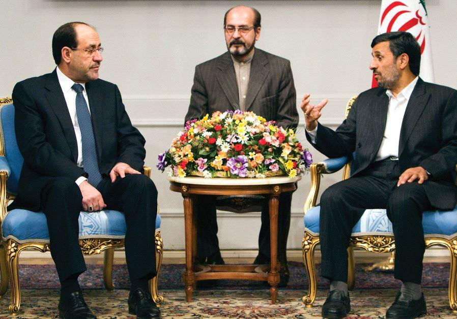 FORMER IRANIAN president Mahmoud Ahmadinejad (right) speaks with Iraqi Prime Minister Nuri al-Maliki