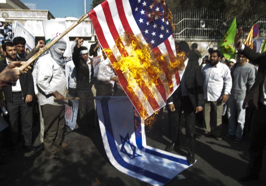 Iranian students burn a US flag.