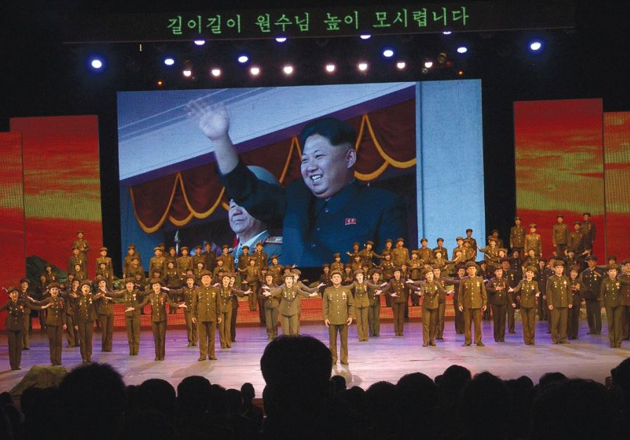 KOREAN DICTATOR Kim Jong-un waves from a giant video screen during a recent military-themed spectacu