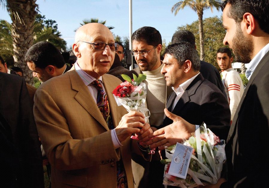 HAMAS LAWMAKERS welcome MP Gerald Kaufman upon his arrival at the Rafah border crossing in the south