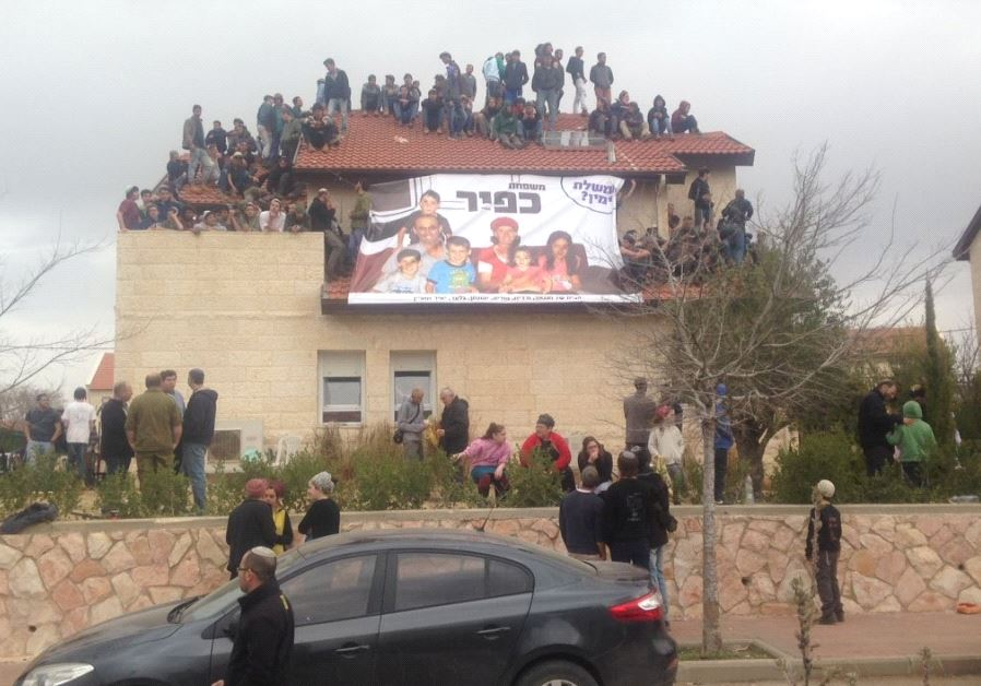 Ofra Youth gather on roof of home slated for demolition