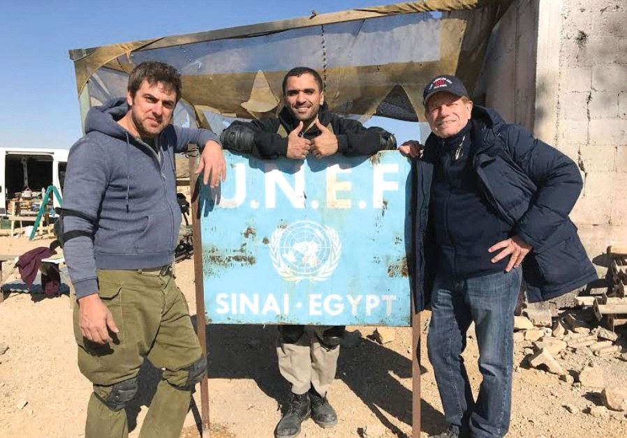 ACTORS YIFTACH KLEIN (left) and Sammy Sheik (center) with director Mike Burstyn on the set of 'Azimu