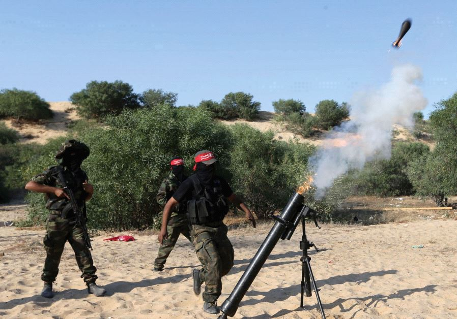 PALESTINIANS FIRE a mortar shell in the southern Gaza Strip in 2015