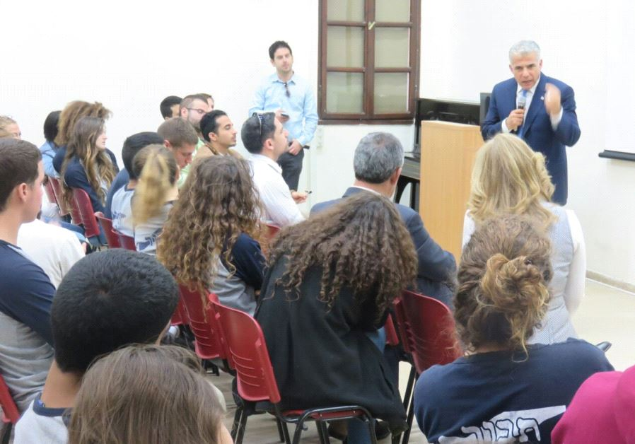 Yesh Atid leader Yair Lapid addressing Nazareth Illit students  about the legacy of former Likud Pri