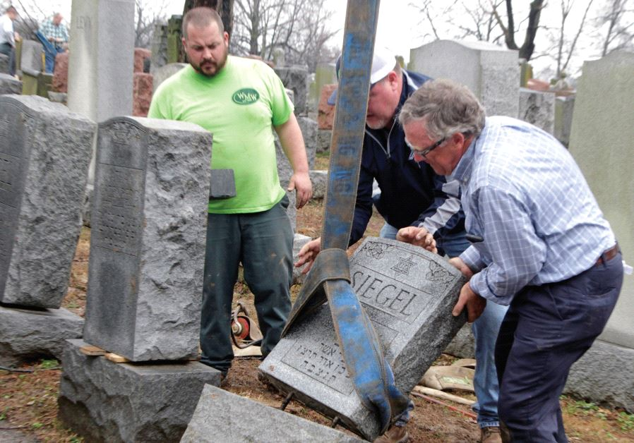 Toppled Jewish headstones