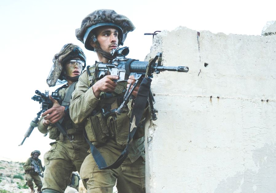 PARATROOPERS TRAIN in urban warfare techniques during last week's exercise in the Jordan Valley.