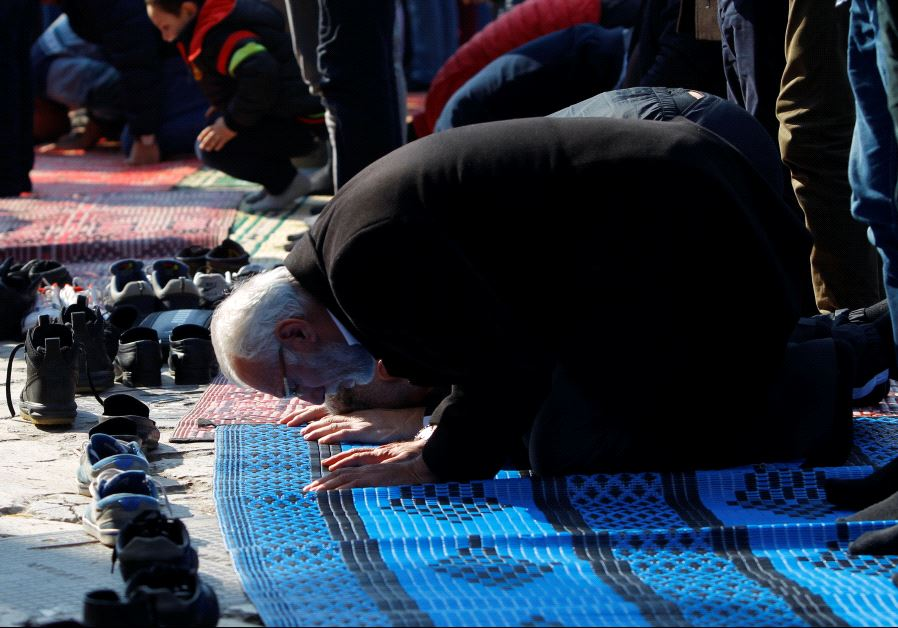 Muslims pray during Friday prayers on the street near the Murat Pasha Mosque in the old town of Skop