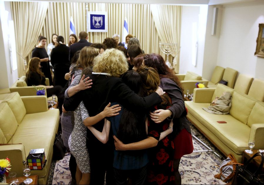 Women who took part in a project ahead of International Women's Day (marked on March 8), hug during