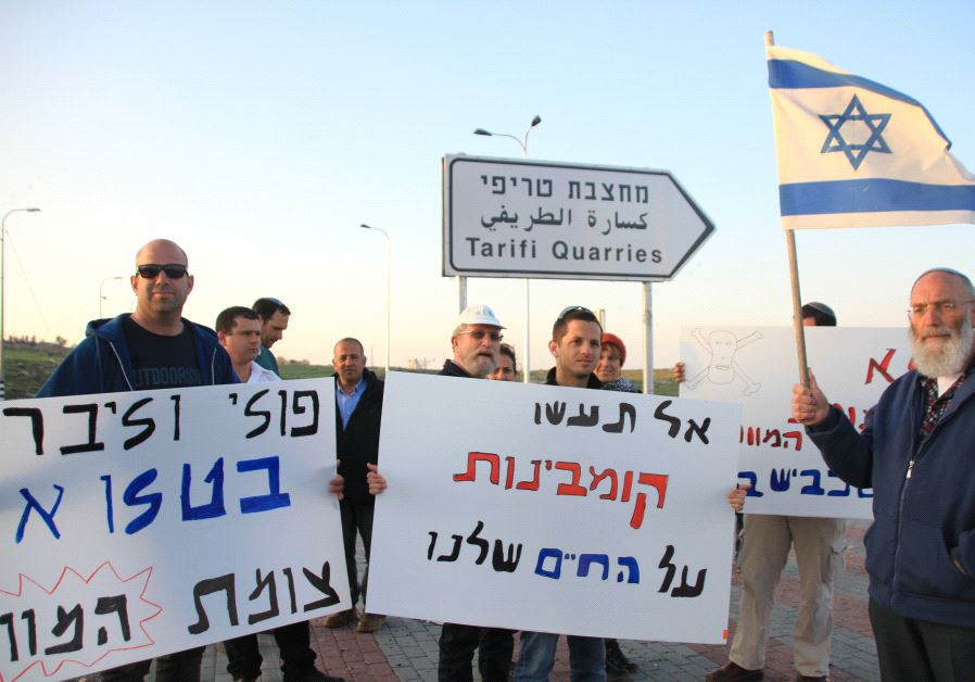 Settlers holding a small demonstration on the new paved turn-off to the road