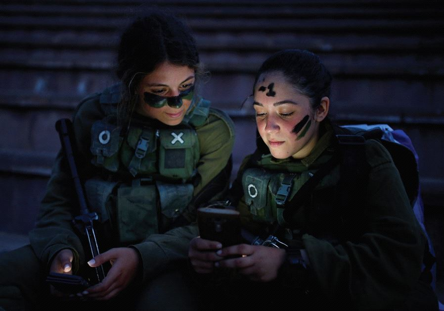 SOLDIERS OF the IDF Search and Rescue brigade rest during a training session.
