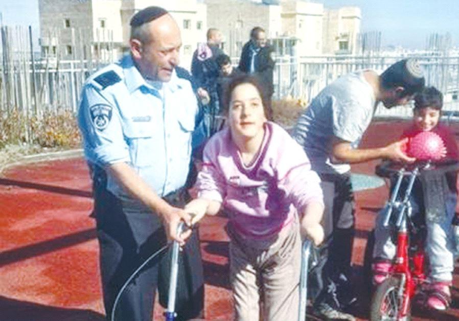 JERUSALEM POLICE OFFICERS train for the 2017 Jerusalem Winner Marathon with their ALEH running partn