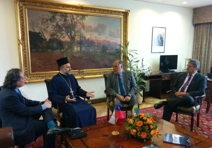 Father Naddaf meets last week with Osvaldo Andrade (second right), the head of the Chamber of Deputi