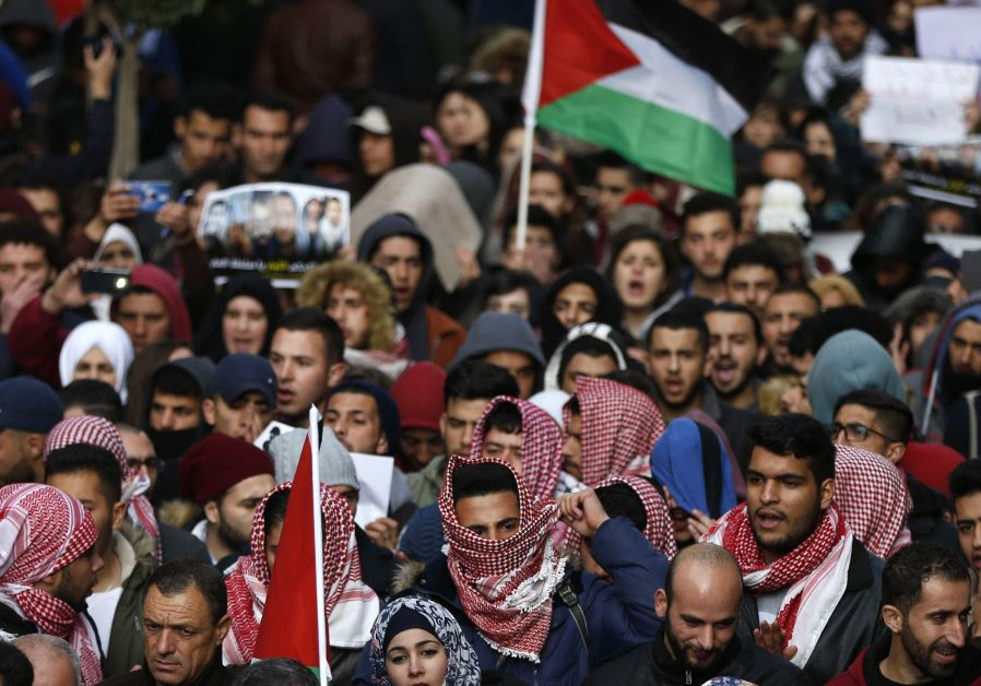 Palestinians demonstrate in the centre of the West Bank city of Ramallah against PA security forces