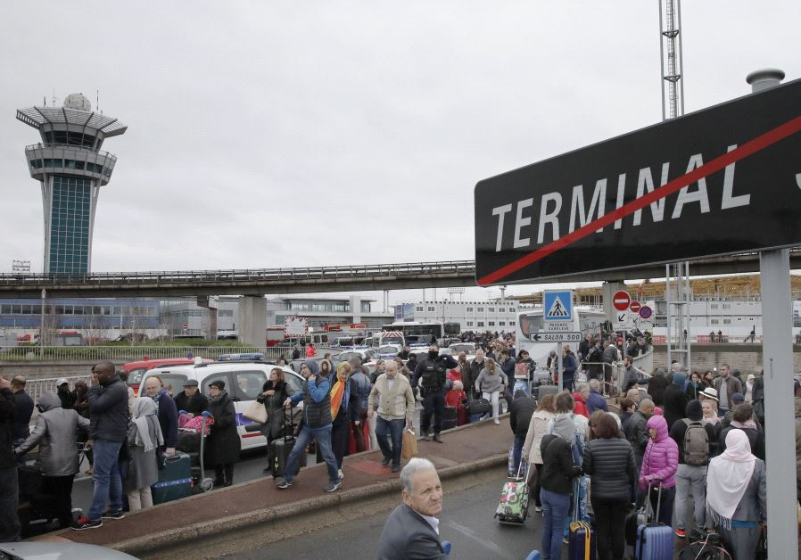 Passengers evacuated from Orly airport southern terminal after a shooting incident near Paris, Franc
