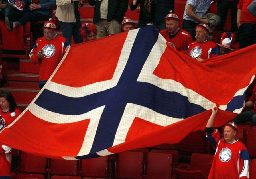 Norway's fans hold up a flag in support of their team
