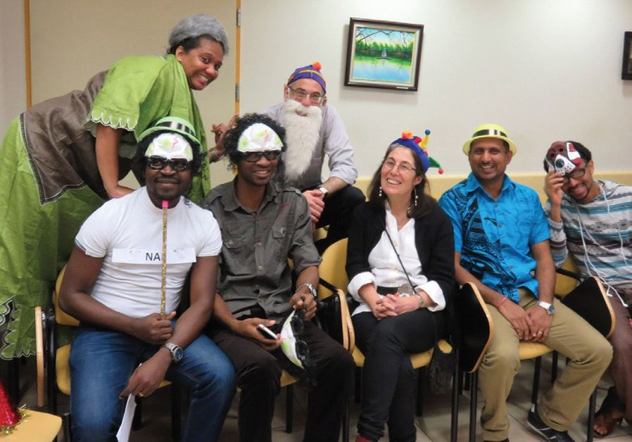 FOREIGN STUDENTS at the school's Purim party with Professor Paltiel.