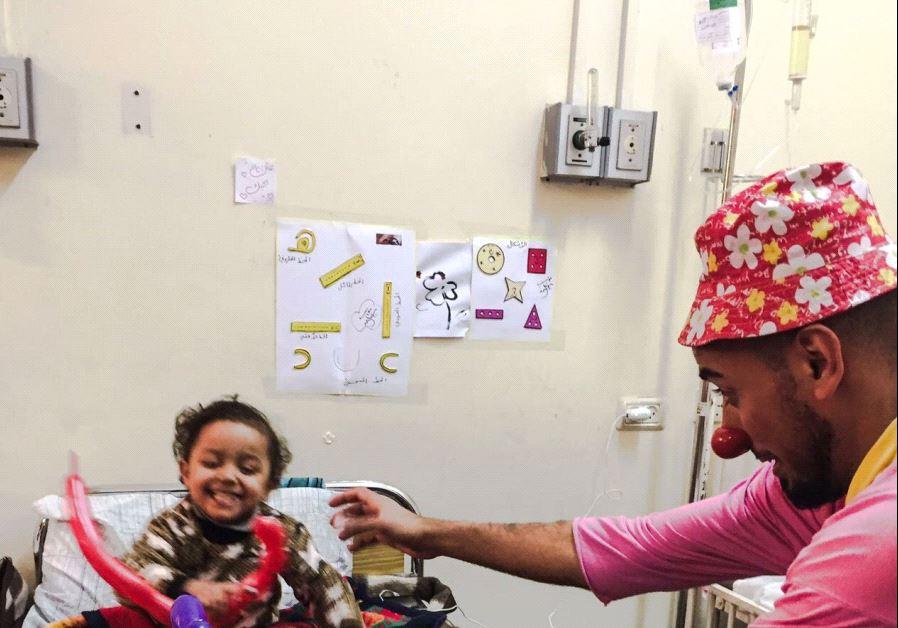 Abdullah Abu Shaaban clowning at al-Rantisi children's hospital in Gaza