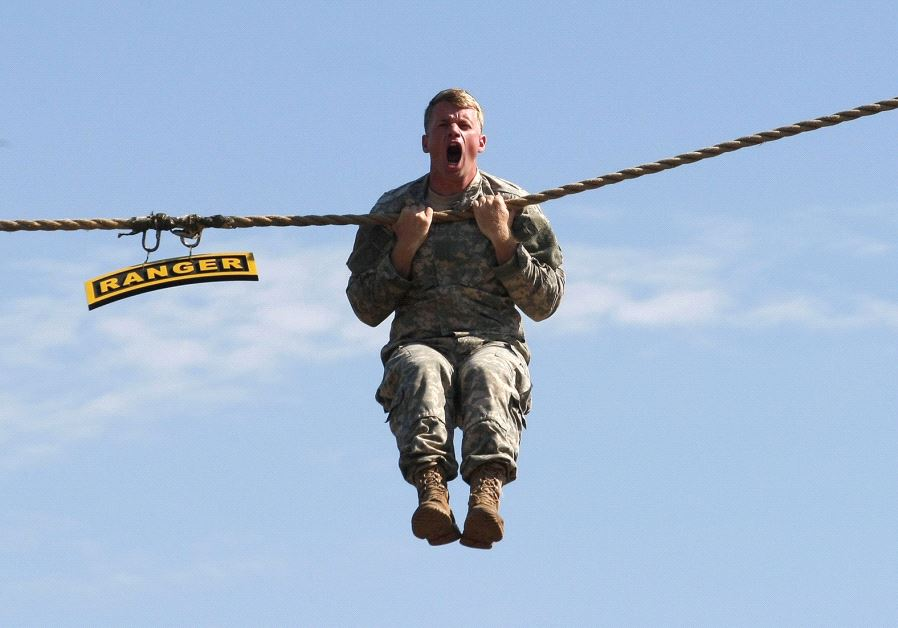 A US ARMY RANGER shows off his skills at Fort Benning, Georgia. 'US forces, along with the local Syr