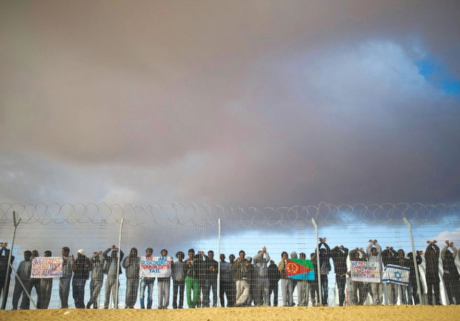 AFRICAN MIGRANTS being held at the Holot detention center in the Negev demonstrate last month for be