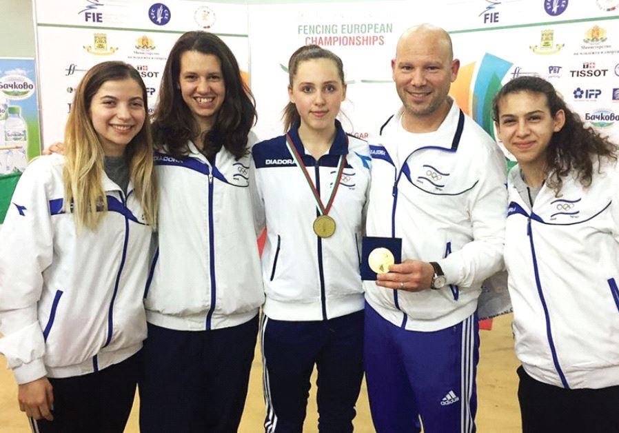 Israeli fenc er Vera Kanevski (center) poses with fellow delegation members (from left) Nikol Gavrie