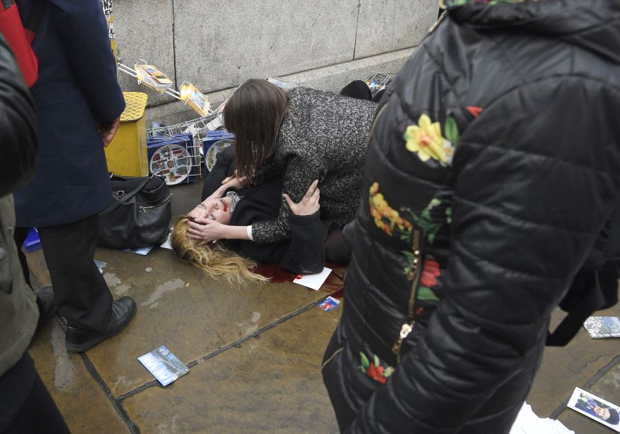 A woman lies injured after an incident on Westminster Bridge in London, March 22, 2017. (Reuters)
