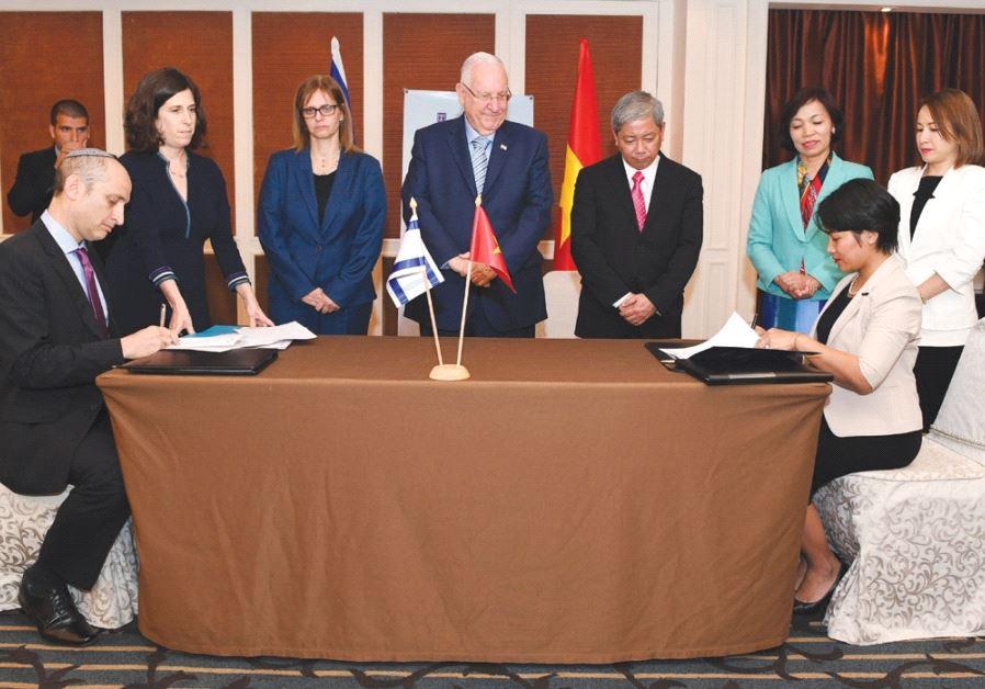 PRESIDENT REUVEN RIVLIN and Ambassador to Vietnam Meirav Shahar (third left) attend yesterday's sign