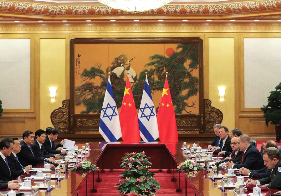 CHINESE AND ISRAELI officials meet at the Great Hall of the People on Monday in Beijing. Israeli bus