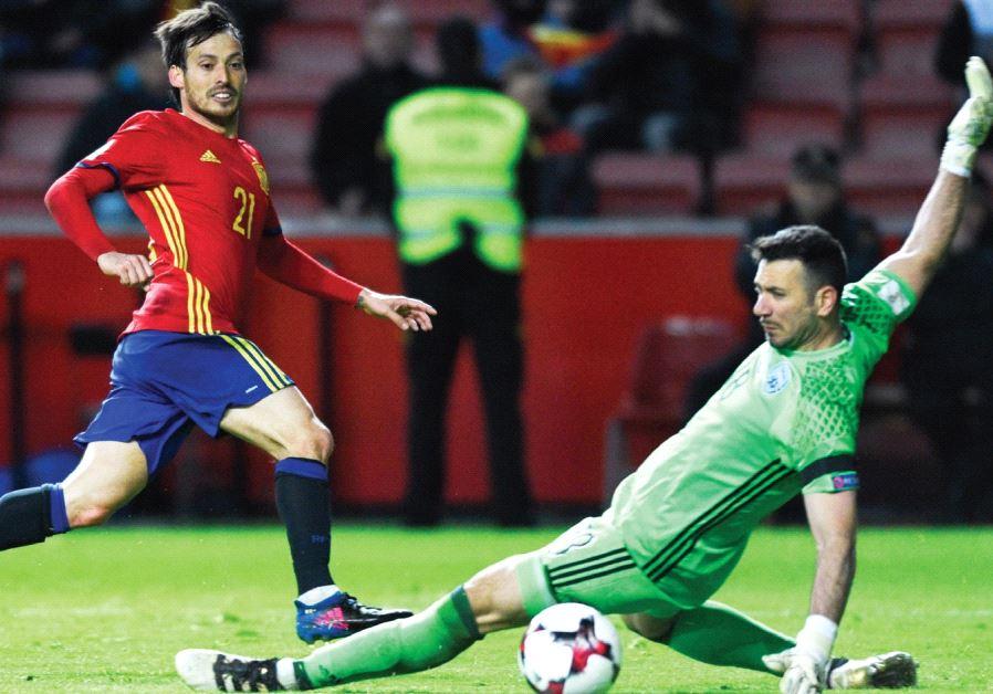 Spain midfielder David Silva (left) scores the opener in Friday's 4-1 win over Israel in 2018 World
