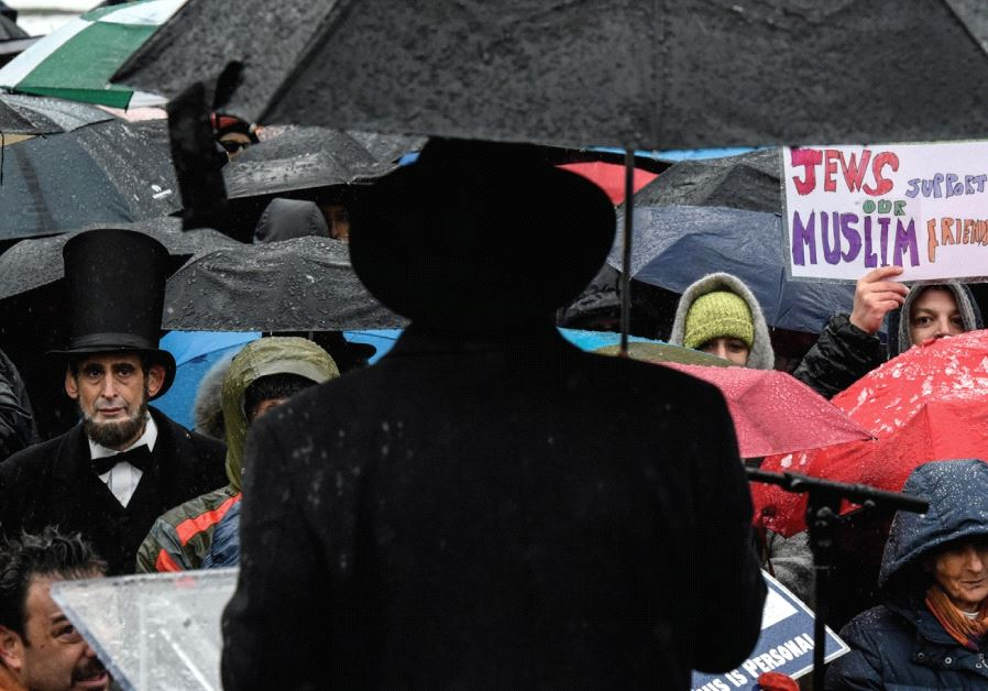 PEOPLE PARTICIPATE in a protest against US President Donald Trump's immigration policy.