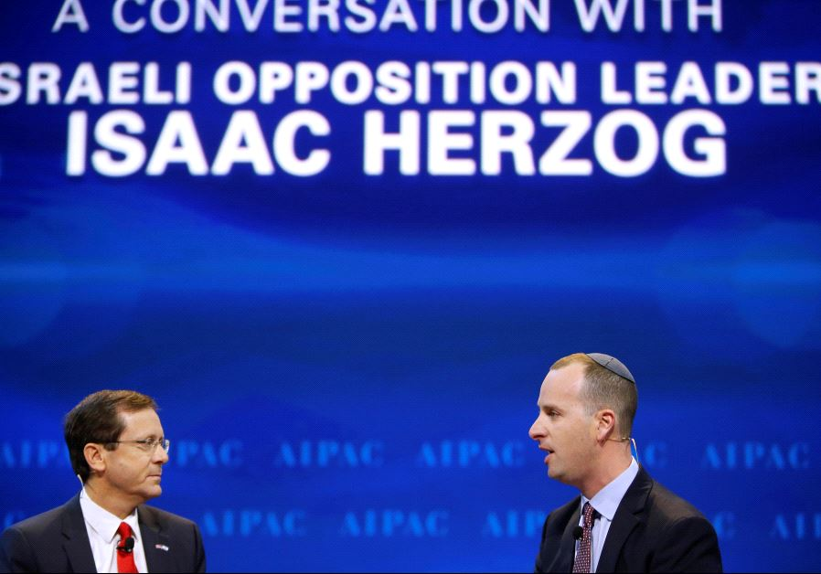 Israeli opposition leader Isaac Herzog (L) is interviewed by Editor-in-Chief of the Jerusalem Post.