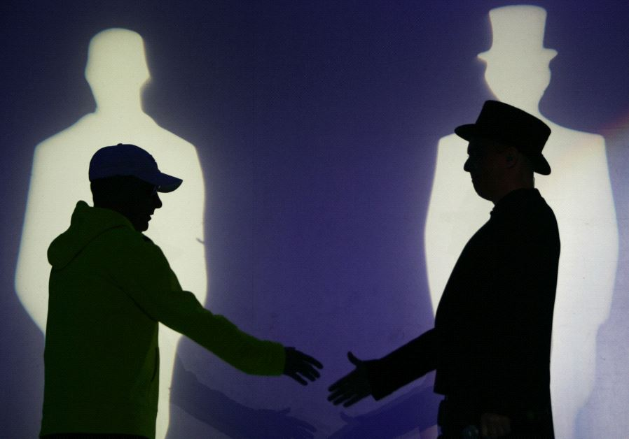"""Chris Lowe (L) and Neil Tennant of the British duo """"Pet Shop Boys"""" perform during a concert"""