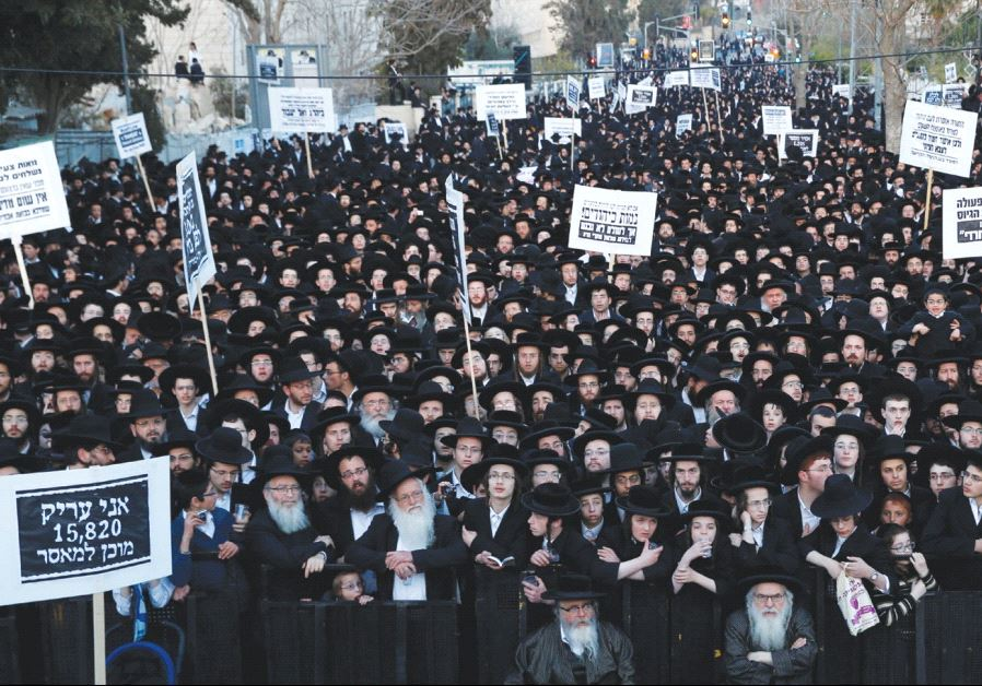 ULTRA-ORTHODOX protesters take part in a demonstration in Jerusalem last night against yeshiva stude