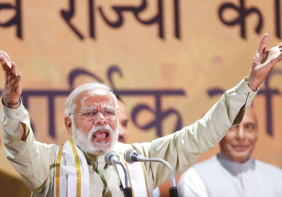 INDIA'S PRIME MINISTER Narendra Modi addresses supporters at BJP headquarters in New Delhi on March