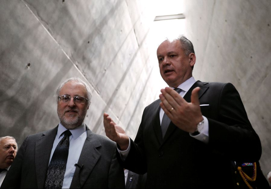 Slovakia's President Andrej Kiska (R) walks during a visit to Yad Vashem's Holocaust History Museum