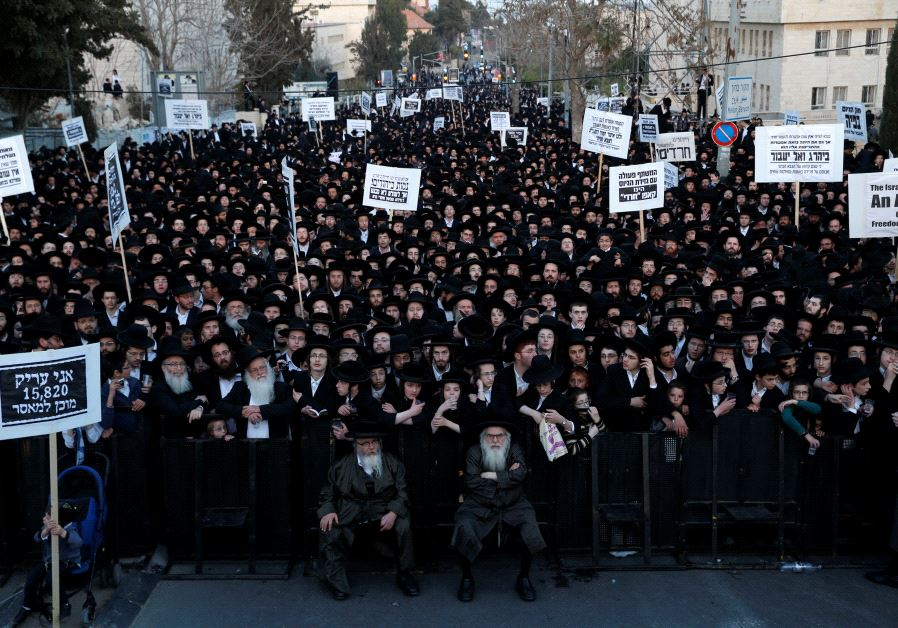 Ultra-Orthodox Jewish protesters take part in a demonstration against members of their community ser
