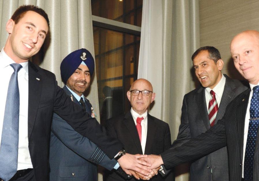 SMILING IN HERZLIYA on Tuesday night are (from left) ISDEF President Tomer Avnon, Indian Ambassador