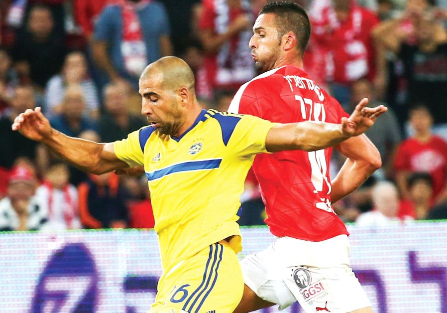 Maccabi Tel Aviv defender Tal Ben-Haim (left) and Hapoel Beersheba striker Ben Sahar (right) are set