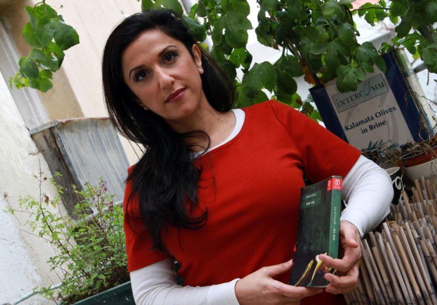 Author Dorit Rabinyan holding her controversial book 'Borderlife.'