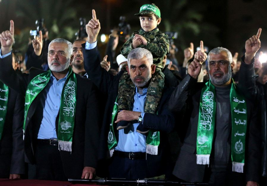 The son of senior Hamas militant Mazen Fuqaha sits on the shoulders of Hamas Gaza Chief Yehya Al-Sin