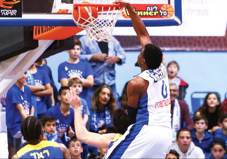 Bnei Herzliya forward Jeff Adrien dunks two of his 27 points during last night's 94-88 home triumph