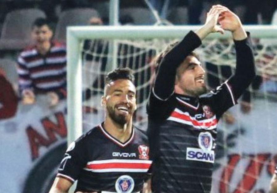 Bnei Sakhnin midfielder Nir Lax (right) celebrates after scoring the winner in last night's 1-0 vict
