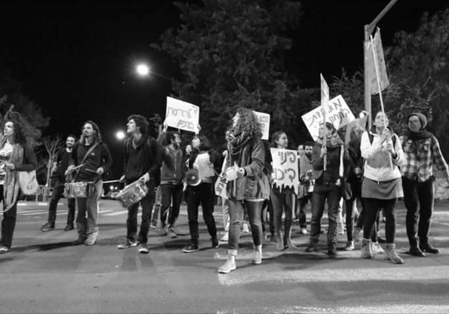 Activists from Free Jerusalem protest in front of Jerusalem Mayor Nir Barkat's home Tuesday night.