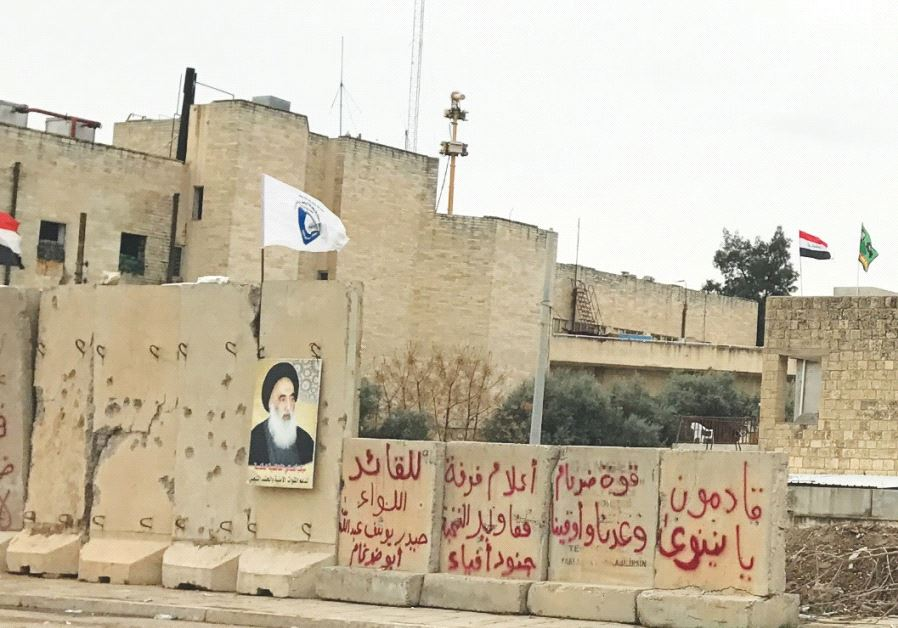 POSTERS ACROSS northern Iraq celebrate Shia religious figures; many see them as symbols of Iranian i