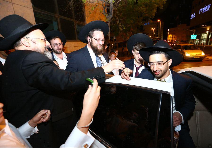 Haredi men celebrating IDF desertion.