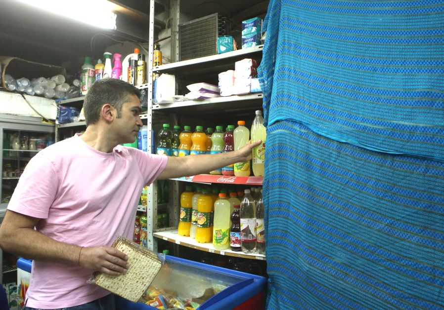 Hametz is covered at a store in Israel