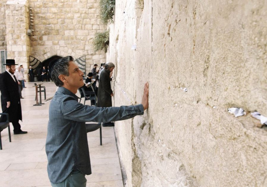 REZA ASLAN, host of CNN's series 'Believer,' stands at the Western Wall in 2015 during the filming o
