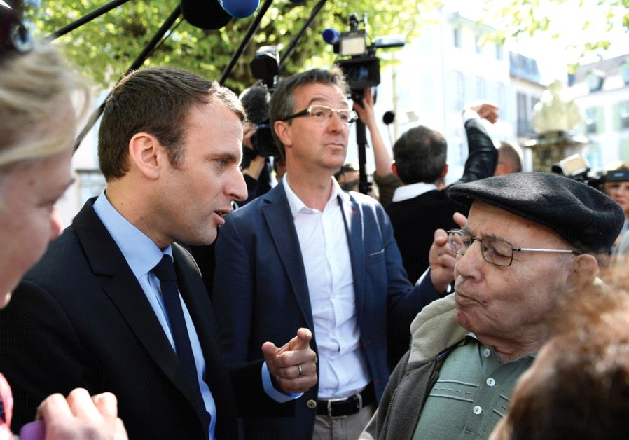 EMMANUEL MACRON talks with residents during a presidential campaign visit yesterday in Bagneres de B