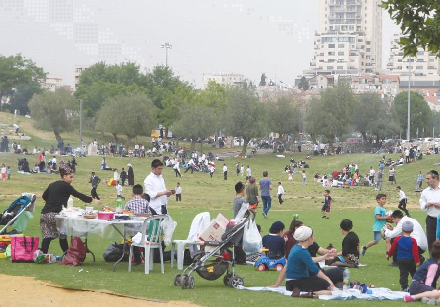 PEOPLE TAKE ADVANTAGE of yesterday's heat wave with a visit to Jerusalem's Sacher Park