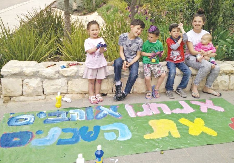 CHILDREN who live near Jerusalem's Mekor Chaim Park took up the call to paint a tarp on Wednesday, t